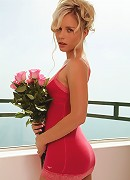 Glam babe Kara Duhe in her skimpy pink dress on the terrace showing her pink panties