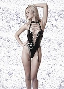 Blonde Nelly in the leather lingerie on black and white photos