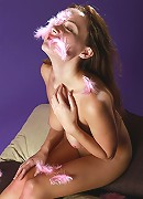 Young naked girl Kamelia playing with feathers