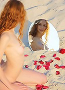 Fun and playful redhead with long and slender body.