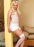 Nubiles.net Praskovia - Hot temptress in stockings spreads her legs exposing her bald pussy