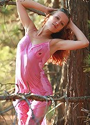 Gella posing in the forest in the wet lingerie