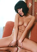 Tanned small titted brunette spreading her pussy