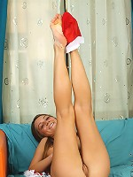 Nubiles.net Arina - Check out this hot babe santa she gets naughty on the sofa and brags her fresh pinkish pussy